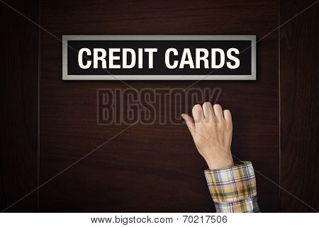 Hand Is Knocking On Credit Cards Door