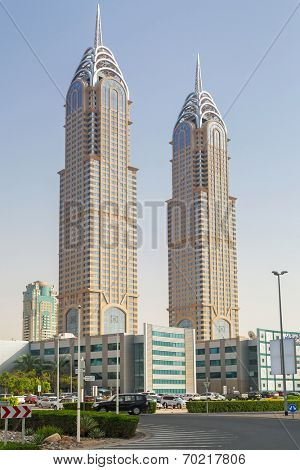 DUBAI, UAE - 2 APRIL 2014: The Al Kazim Towers in Dubai Media City at night on 30 March 2014. The Al Kazim Towers is a complex of two 53-floor towers, resemble to the New York City's Chrysler Building