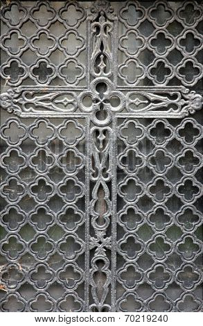PARIS - NOVEMBER 07: Beautiful ornate tomb door in the Pere Lachaise cemetery in Paris November 07, 2012 in Paris, France.