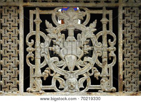PARIS - NOVEMBER 07:Beautiful ornate tomb door in the Pere Lachaise cemetery in Paris November 07, 2012 in Paris, France.