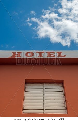 Hotel Sign, Text At Building Facade Wall With Window