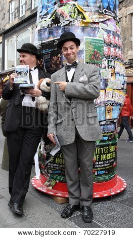 EDINBURGH- AUGUST 16: Members of Lucky Dog Theatre Productions publicize their show Hats Off To Laurel and Hardy during Edinburgh Fringe Festival on August 16, 2014 in Edinburgh Scotland