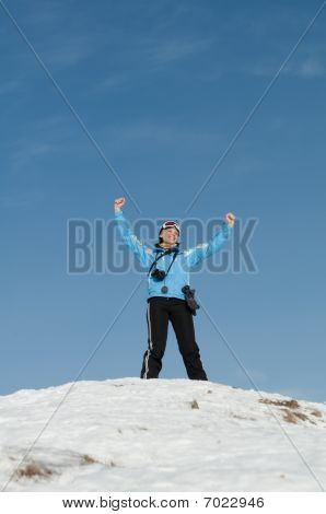 Girl Skier On The Mountain Peak