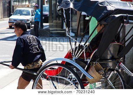 Tourists take a rickshaw in japan
