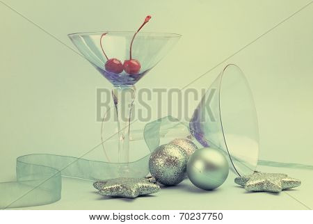 Festive Spirit Blue Martini Cocktail Glasses With Red Maraschino Cherries And Christmas Baubles On A