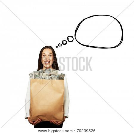 excited young woman holding paper bag with money over white background. concept photo with drawing speech bubble