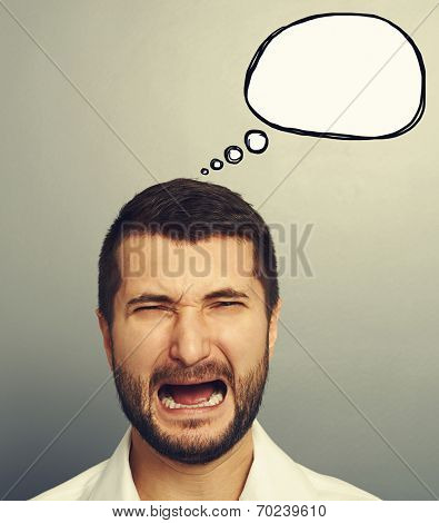 portrait of emotional crying man with empty speech balloon over grey background