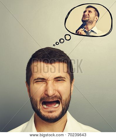 concept photo of stressed screaming man. in speech balloon crying man with gun. photo over grey background