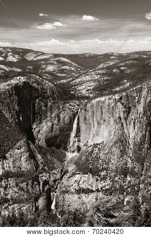 Yosemite mountain ridge with waterfall in BW.