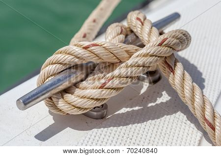 Nautical Knot Rope Tied Around Stake On Boat Or Ship