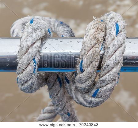 Knot Rope Tied Around Steel Holder On Boat Or Yacht