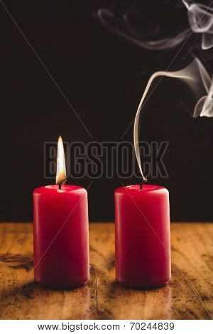 Burning And Blown Out Candle with Smoke