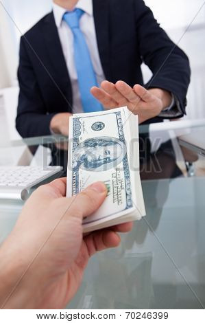 Businessman Refusing To Take Bribe From Man