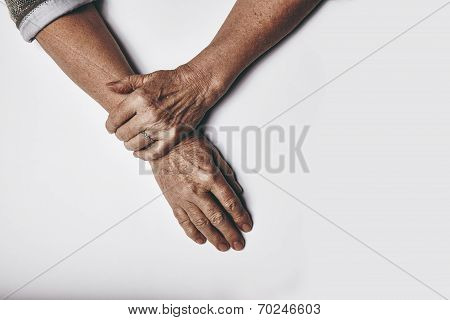 Elderly Woman's Hands On Grey Background