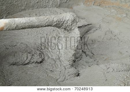 Spade And Wet Cement