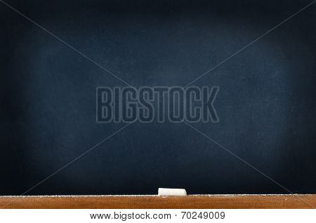 Blackboard With Chalk And Dust