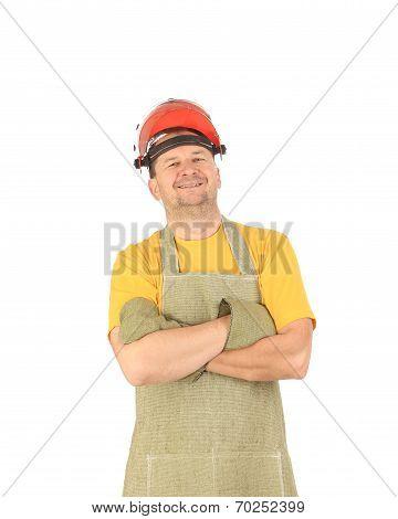 Smiling welder in apron.