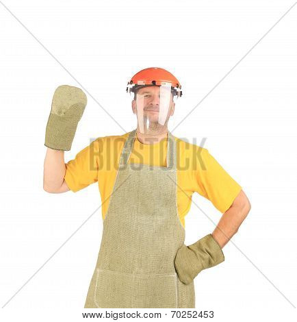 Welder with protective face shield and apron.
