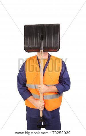 Worker in reflective waistcoat hiding face.
