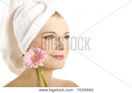Close-up Portrait Of Young Beautiful Woman With Healthy Pure Skin And Wet Hair In A Towel Holding Pi