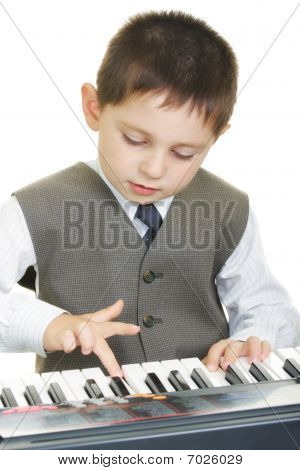 Boy Playing Electric Piano