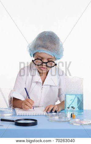 Pharmacist Writing In A Notebook