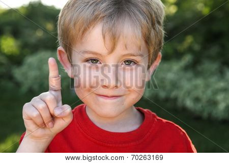 Smiling boy with a bandaged finger