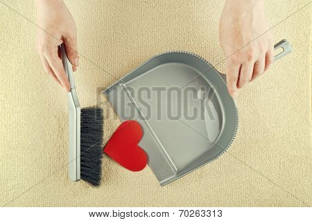 Hand Sweeping Heart From The Floor