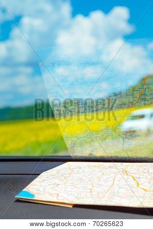 Europe road trip, map inside the car on dashboard, traveling around the world concept, summer adventures, vacation tour to Tuscany, Italy