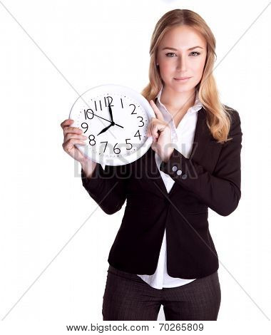 Portrait of beautiful young business woman holding in hands clock, isolated on white background, discipline and punctual concept