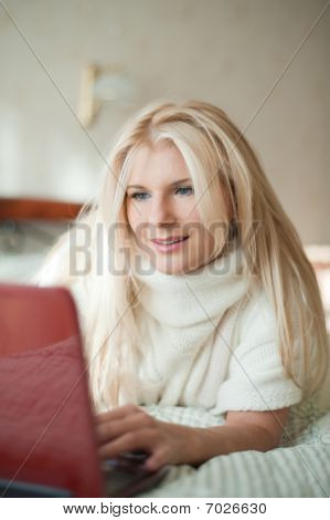 young beautiful woman relaxing with laptop