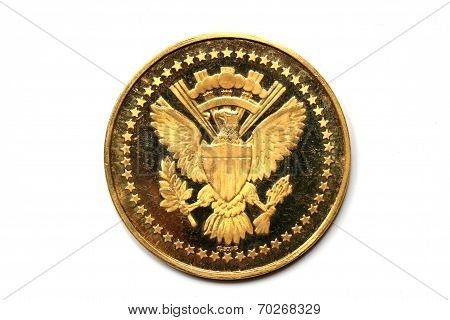 Back side of a gold coin President Kennedy