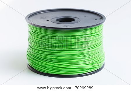 Filament For 3D Printer In Light Green Against A Bright Background