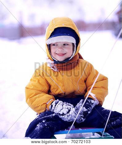 happy boy with sled