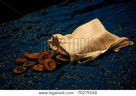 Divination Runes On Blue Cloth