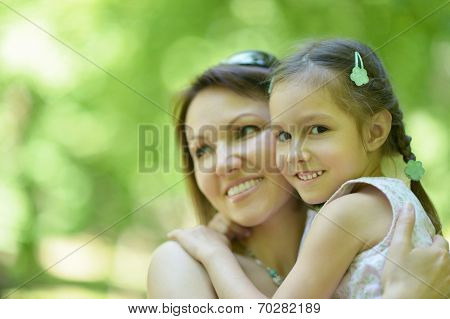 Mother with daughter in summer