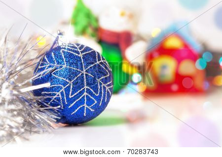 Blue Christmass Ball With Blury Festive Glitter Lights Background