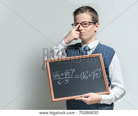 Clever schoolboy in glasses with mathematical equation