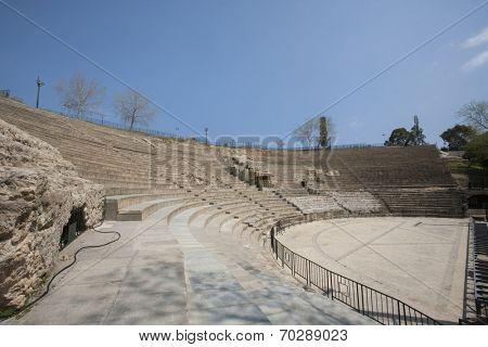 Roman amphitheater against blue sky; Tunis; Tunisia