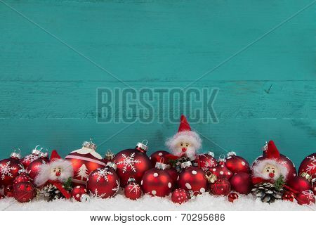 Turquoise Green Wooden Christmas Background With Red Balls.