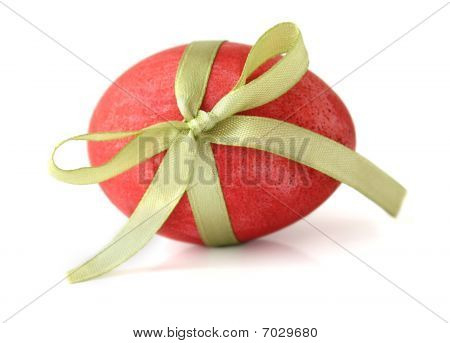 Red Easter Egg tied with a ribbon