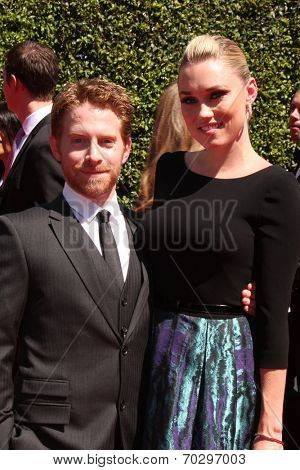LOS ANGELES - AUG 16:  Seth Green, Clare Grant at the 2014 Creative Emmy Awards - Arrivals at Nokia Theater on August 16, 2014 in Los Angeles, CA