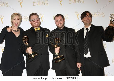 LOS ANGELES - AUG 16:  Jane Lynch, Deadliest Catch Picture Editors at the 2014 Creative Emmy Awards - Press Room at Nokia Theater on August 16, 2014 in Los Angeles, CA