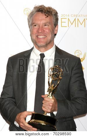 LOS ANGELES - AUG 16:  Tate Donovan at the 2014 Creative Emmy Awards - Press Room at Nokia Theater on August 16, 2014 in Los Angeles, CA