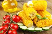 pic of corn cob close-up  - Grilled corn cobs on table - JPG