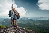 stock photo of selfie  - Two hikers taking selfie on top of the mountain - JPG