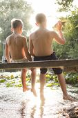 foto of dock a pond  - best friends playing by the water - JPG