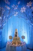 picture of beside  - a gourmet wedding cake with two bouquet beside it - JPG