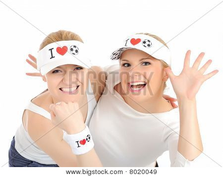 Two Pretty Football Fan Girls In Funny Hats. Isolated On White Background