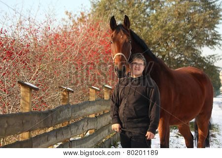 Plump Happy Teenager Boy And Brown Horse Portrait